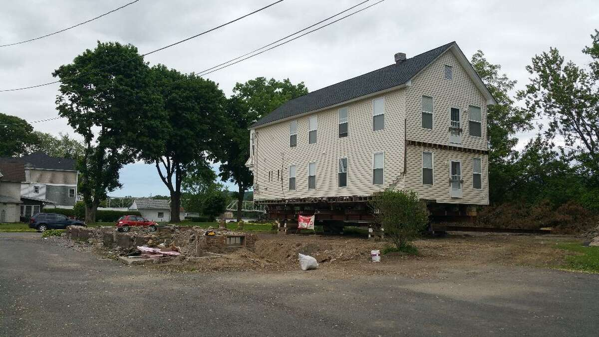 The two-family apartment building at 6 Front St., Waterford was lifted off its existing foundation and moved to the side yard while a new foundation was installed. (Photo provided by Tino Demarco)