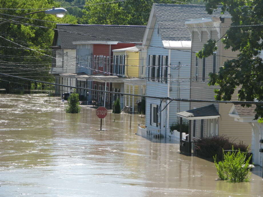 Flooding along Front Street, Waterford in August, 2011. (Photo provided by Tino Demarco) Photo: Provided By Tino Demarco