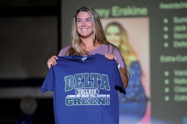 Meridian High School senior Aubrey Erskine holds up a Delta College t-shirt during Decision Day at the high school on Thursday, May 16, 2019.