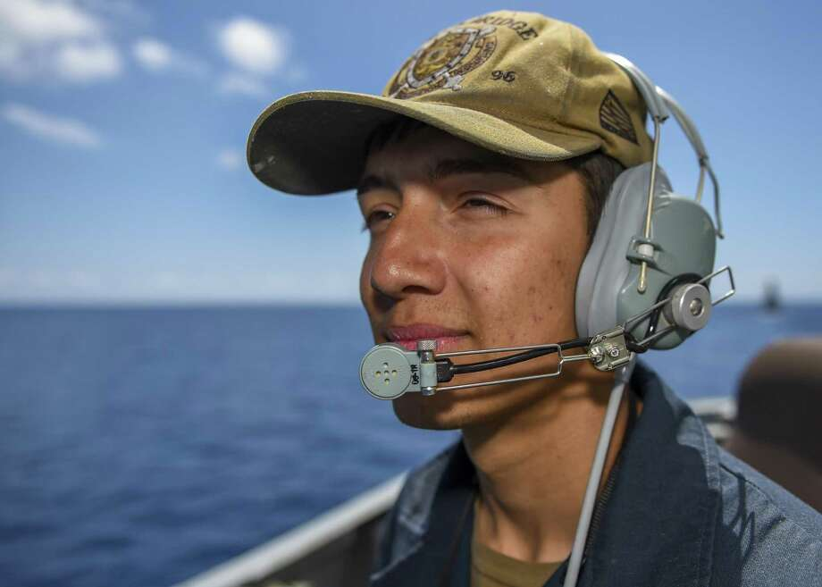 0042 IONIAN SEA — Seaman Eric Wells, from Houston, Texas, stands watch aboard the Arleigh Burke-class guided-missile destroyer USS Bainbridge (DDG 96). Bainbridge is underway as part of the Abraham Lincoln Carrier Strike Group (ABECSG) deployment in support of maritime security cooperation efforts in the U.S. 5th, U.S. 6th and U.S. 7th Fleet areas of operation. With Abraham Lincoln as the flagship, deployed strike group assets include staffs, ships and aircraft of Carrier Strike Group 12 (CSG 12), Destroyer Squadron 2 (DESRON 2) and Carrier Air Wing 7 (CVW 7); as well as Álvaro de Bazán-class frigate ESPS Méndez Núñez (F-104) . Photo: Mass Communication Specialist Seaman Jason Waite, Mass Communication Specialist / U.S. Navy
