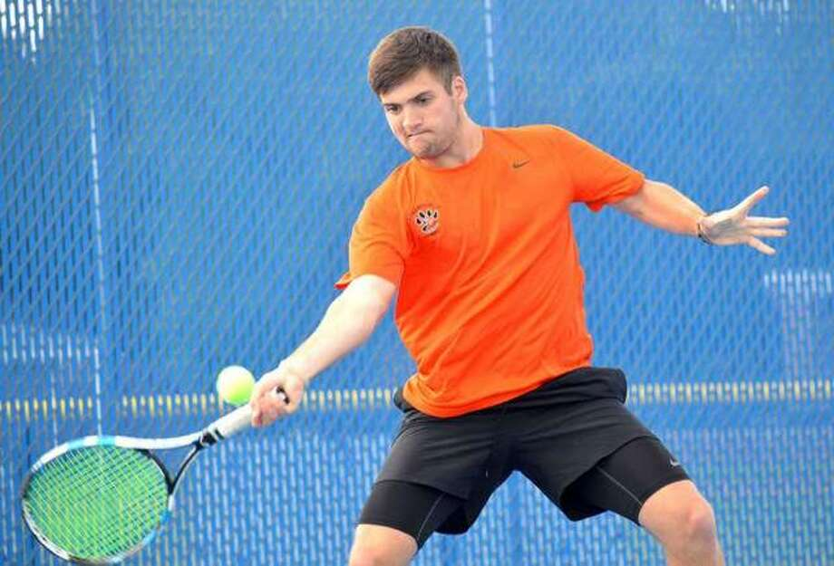 Edwardsville senior Seth Lipe returns a shot in his No. 2 singles final on Monday in the Southwestern Conference Tournament at Belleville East. Photo: Scott Marion/The Intelligencer
