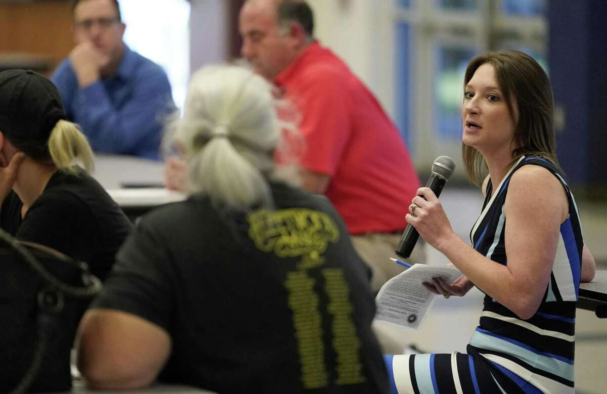 Samantha Reiter, interim general manager of the Lone Star Groundwater Conservation District, right, speaks at the recent community meeting.