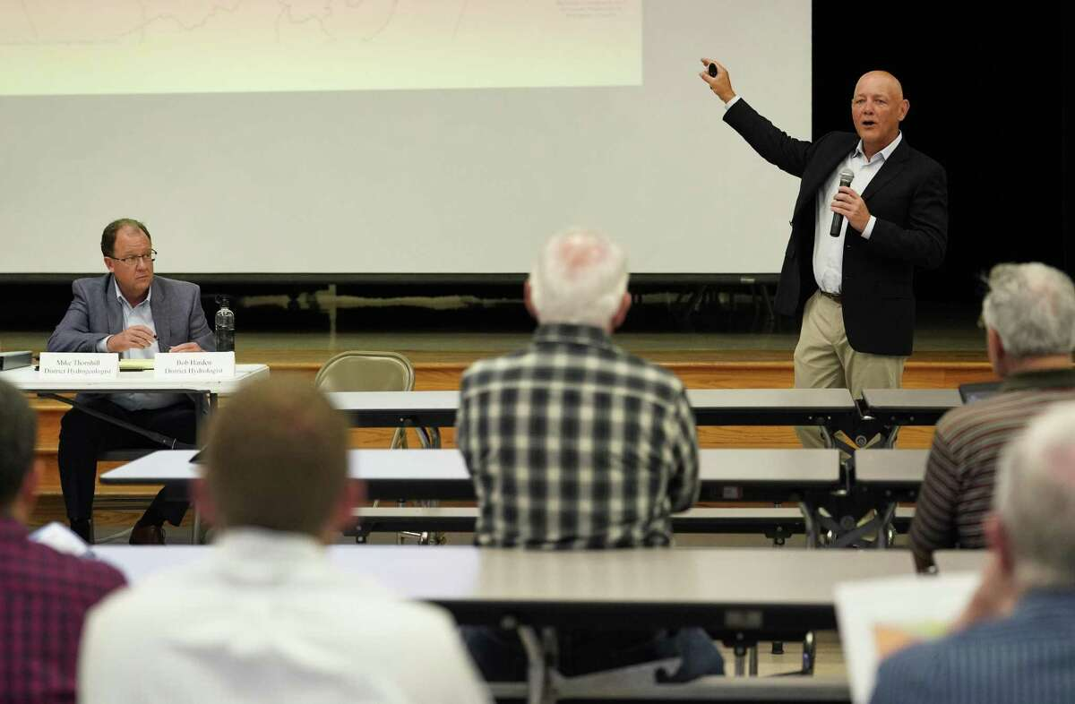Bob Harden, a district hydrologist, right, speaks during the meeting at Bear Branch Elementary School.