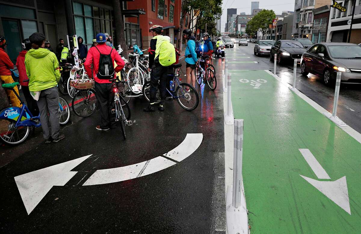 Cyclists pause for a moment of silence at Howard and Sixth streets during the May 2019 Ride of Silence honoring cyclists killed in San Francisco.