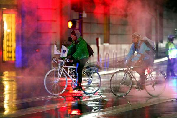 Riders approach City Hall where they would install a Ghost Bike during the Ride of Silence honoring killed cyclists in San Francisco, Calif., on Wednesday, May 15, 2019. Every year, San Francisco cyclists convene for a Ride of Silence to visit the memorials of people killed while riding through the city's crowded, chaotic streets. Traffic deaths spiked this year after a two-year dip, even as the city rushes to paint crosswalks, widen curbs, put up barriers along bike lanes and make other Vision Zero improvements.