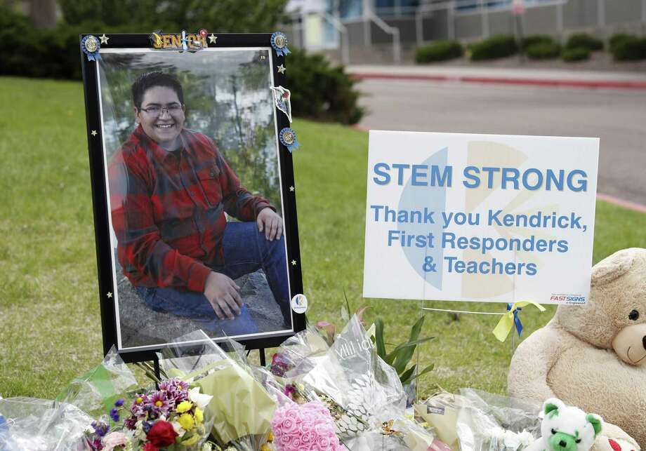 A photograph of student Kendrick Castillo stands amid a display of tributes outside the STEM School Highlands Ranch a week after the attack on the school that left Castillo dead and others injured in Highlands Ranch, Colo. Photo: David Zalubowski / Associated Press / Copyright 2019 The Associated Press. All rights reserved.