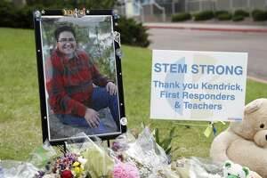 A photograph of student Kendrick Castillo stands amid a display of tributes outside the STEM School Highlands Ranch a week after the attack on the school that left Castillo dead and others injured in Highlands Ranch, Colo.