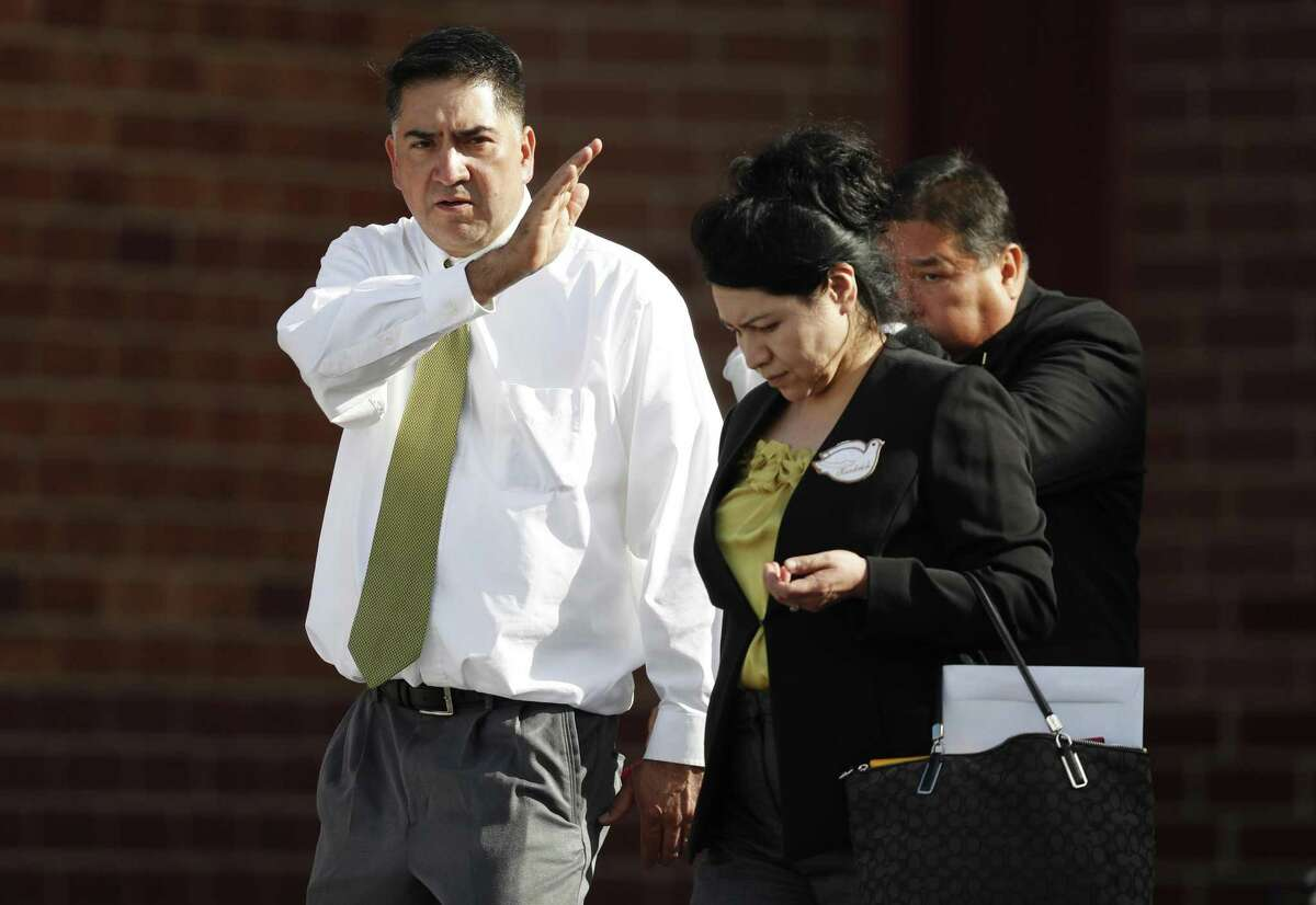 Flanked by his wife, Maria, John Castillo, left, makes the sign of the cross as he leaves the memorial service for his son, Kendrick, who was killed in the attack on the STEM School Highlands Ranch, Wednesday, May 15, 2019, in Highlands Ranch, Colo. Castillo, said it was no surprise to him and his wife, Maria, that their son acted as he did on May 7, when he and two classmates disarmed one of the suspects. He urged those in attendance to be more like his son and put love and compassion for others first.