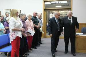 A chamber full of family, friends and community members watched Humble Mayor Merle Aaron escort Ray Calfee to his rocking chair thanking him for his service in Position 2 on the Humble City Council.