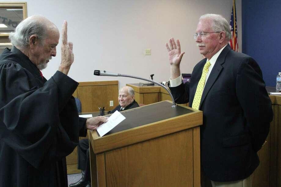Position 2 Board Member Glenn Redmon was sworn in by Presiding Judge Vic Pecorino Photo: Kaila Contreras/Staff Photo