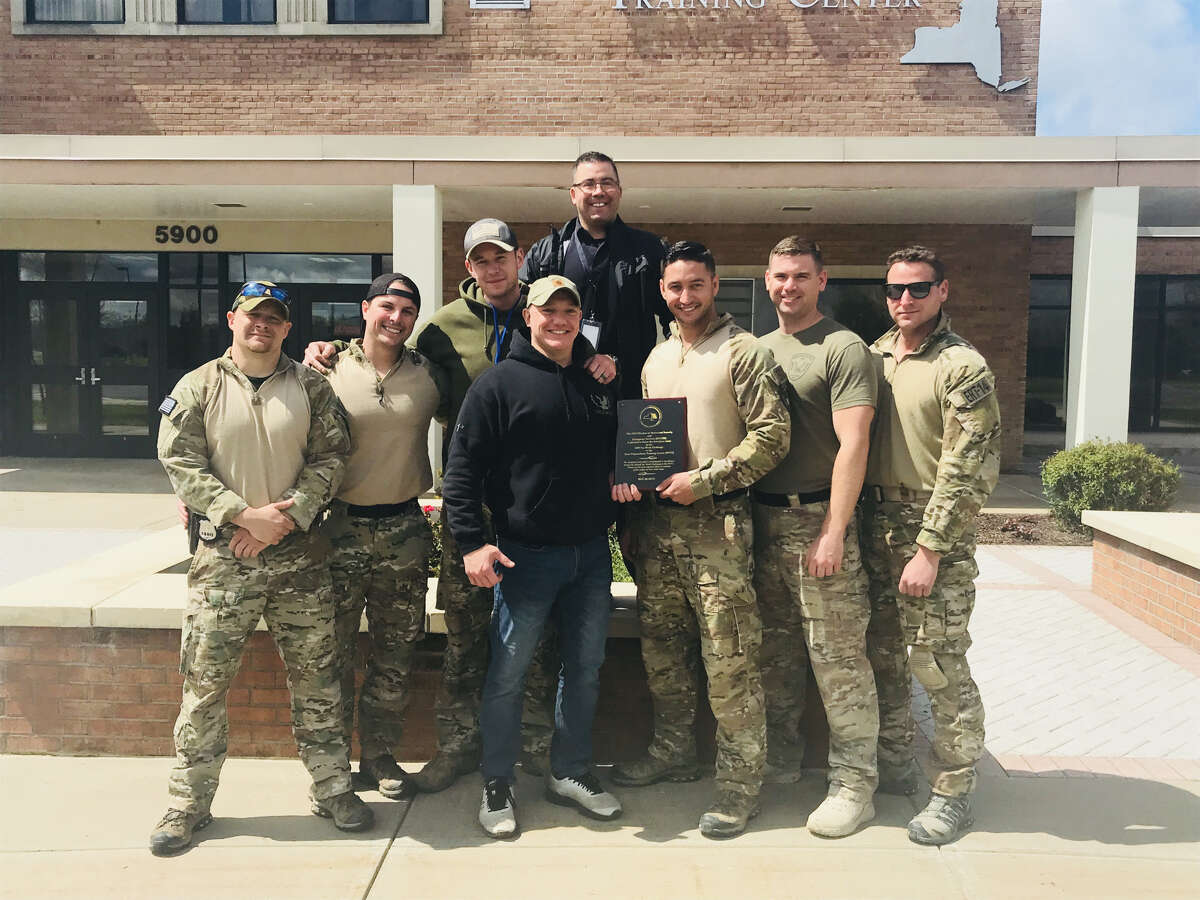 The Troy Police Department's tactical team poses for a photo on May 16, 2019, after winning a competition at the state's Tactical Week training event in Oriskany, N.Y.