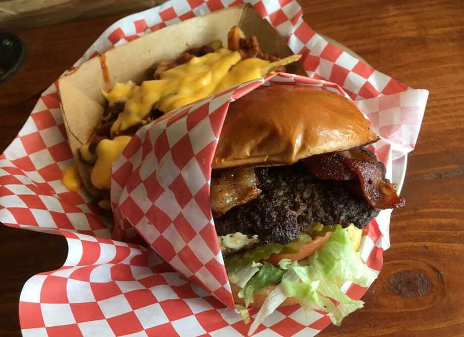 The Gains is a burger that comes with a half-pound beef patty, grilled chicken breast and bacon with the traditional toppings. Photo: Chuck Blount /Staff
