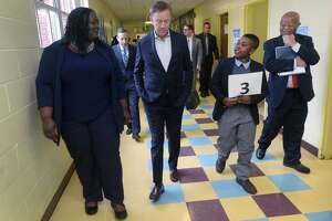 Governor Ned Lamont, second from left, tours Tracey Elementary School with principal Theresa Rangel, 5th grader Adrien Danso, and Dr. James Comer, Founder of the Yale Child Study Center, Wednesday January 16, 2019, prior to a roundtable discussion hosted by the Dalio Foundation at the school in Norwalk, Conn. The event will highlight the forthcoming release of a report from The Aspen Institute National Commission on Social, Emotional, and Academic Development titled, From a Nation at Risk to a Nation at Hope, which outlines steps officials should take to improve public education in the United States.