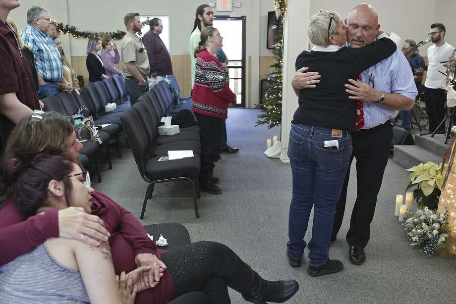 Members of First Baptist Church of Sutherland Springs have showed strength and resilience since the day a gunman killed 26 worshippers. Here, Pam Hollingworth embraces pastor Frank Pomeroy on Dec. 23. Photo: Lisa Krantz / Staff Photographer / San Antonio Express-News