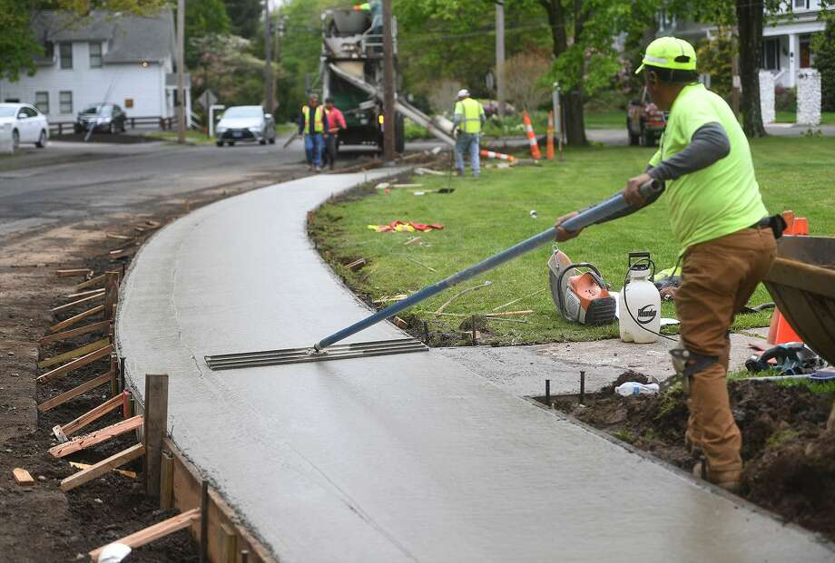 Workers from Edo Construction install a new cement sidewalk on North Street in Milford, Conn. on Tuesday, May 14, 2019. Photo: Brian A. Pounds / Hearst Connecticut Media / Connecticut Post