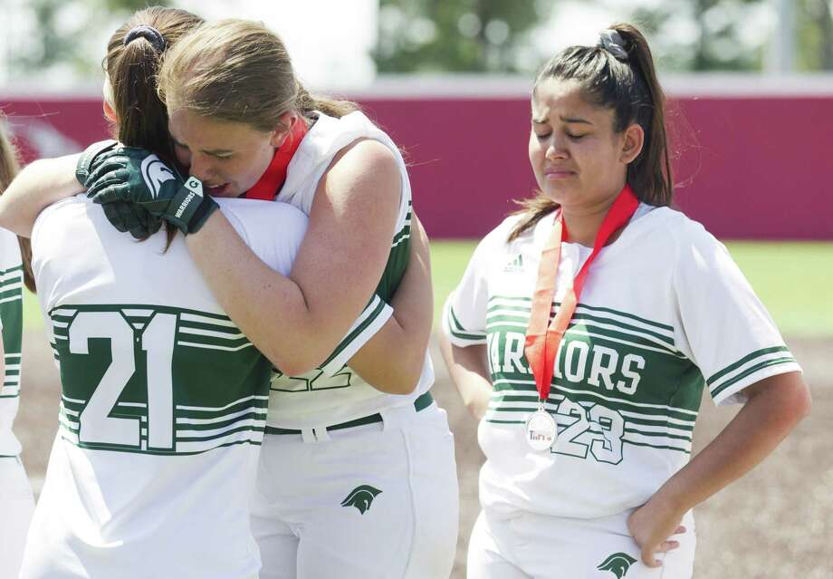 The Woodlands Christian Academy starting pitcher Faith Hanshaw hugs Reagan Robicheaux beside Mariska Cohelo after losing to Waco Reicher 10-2 in the TAPPS Division III state championship game at The Ballparks in Crosby, Thursday, May 16, 2019, in Crosby. Photo: Jason Fochtman, Houston Chronicle / Staff Photographer / © 2019 Houston Chronicle