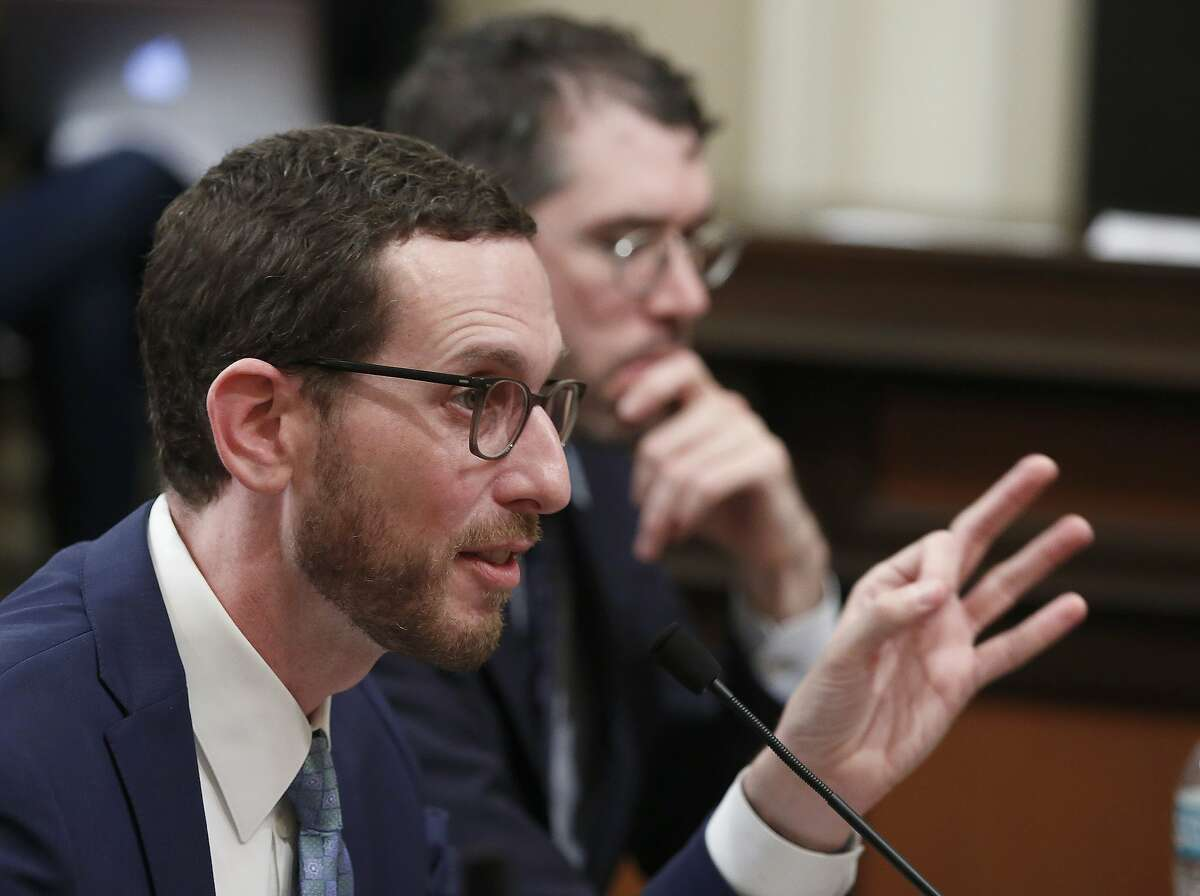 State Sen. Scott Wiener, D-San Francisco, left, discusses his housing measure during a committee hearing Wednesday, April 24, 2019, in Sacramento, Calif. Wiener's bill, SB50, that would increase housing near transportation and job hubs was approved by the Senate Governance and Finance Committee, after it was merged with SB4, a measure by State Sen. Mike McGuire, D-Healdsburg.