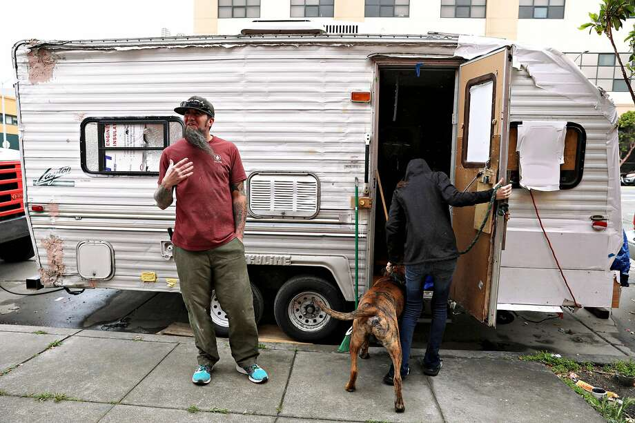 James Janisse and his wife, Lisa Janisse (right), have lived in a travel trailer on Cesar Chavez Street for about a year. Photo: Lea Suzuki / The Chronicle