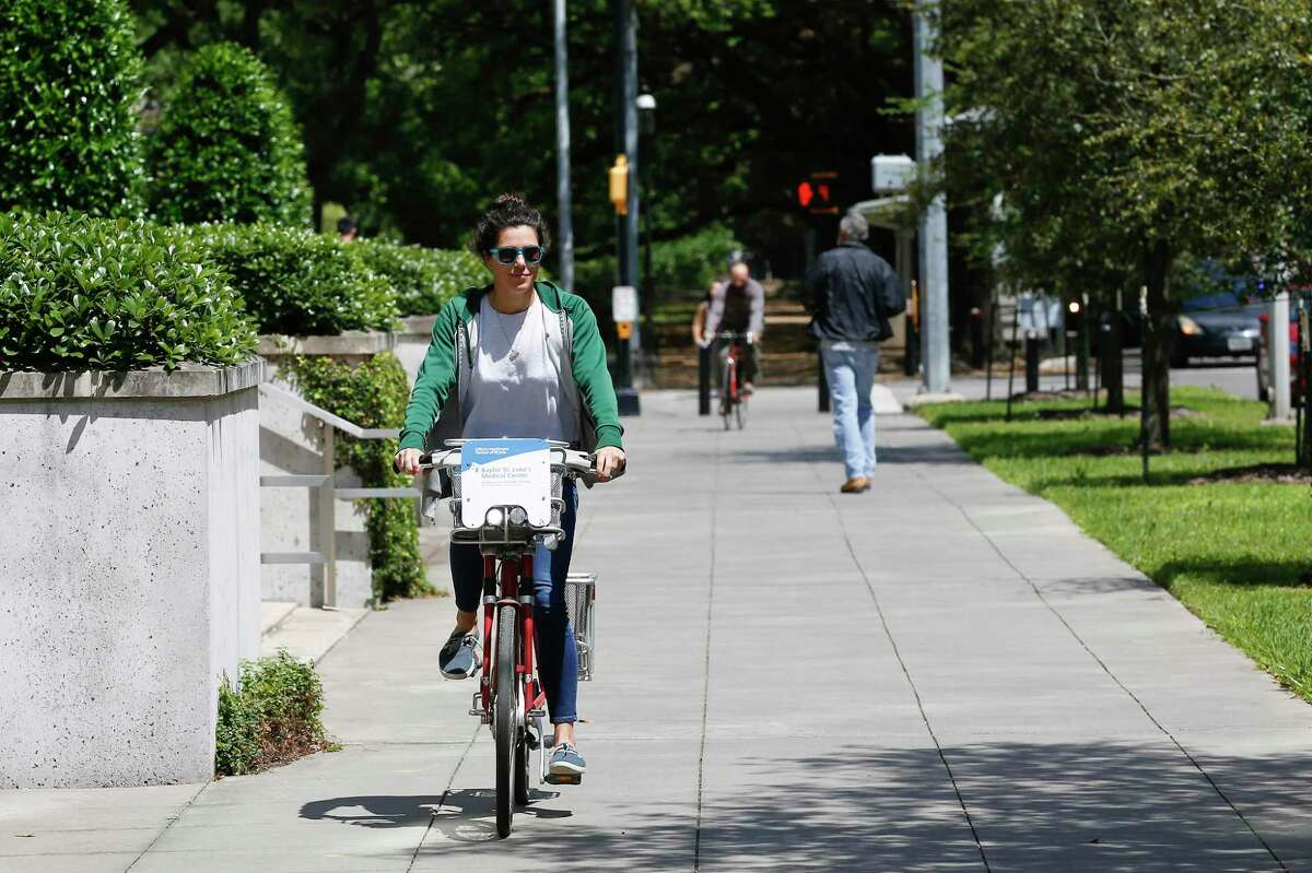 """""""I use it all the time to go and get coffee or to run quick errands"""" Gisele Caleron said as she checked out a B-Cycle bike sharing system bike in the Med Center on April 2, 2019, in Houston. The city unveiled its climate action plan Thursday, July 26, 2019, in which it sets a pathway to become carbon neutral by 2050. One way to reduce emissions is by promoting alternate modes of transportaiton, including biking."""