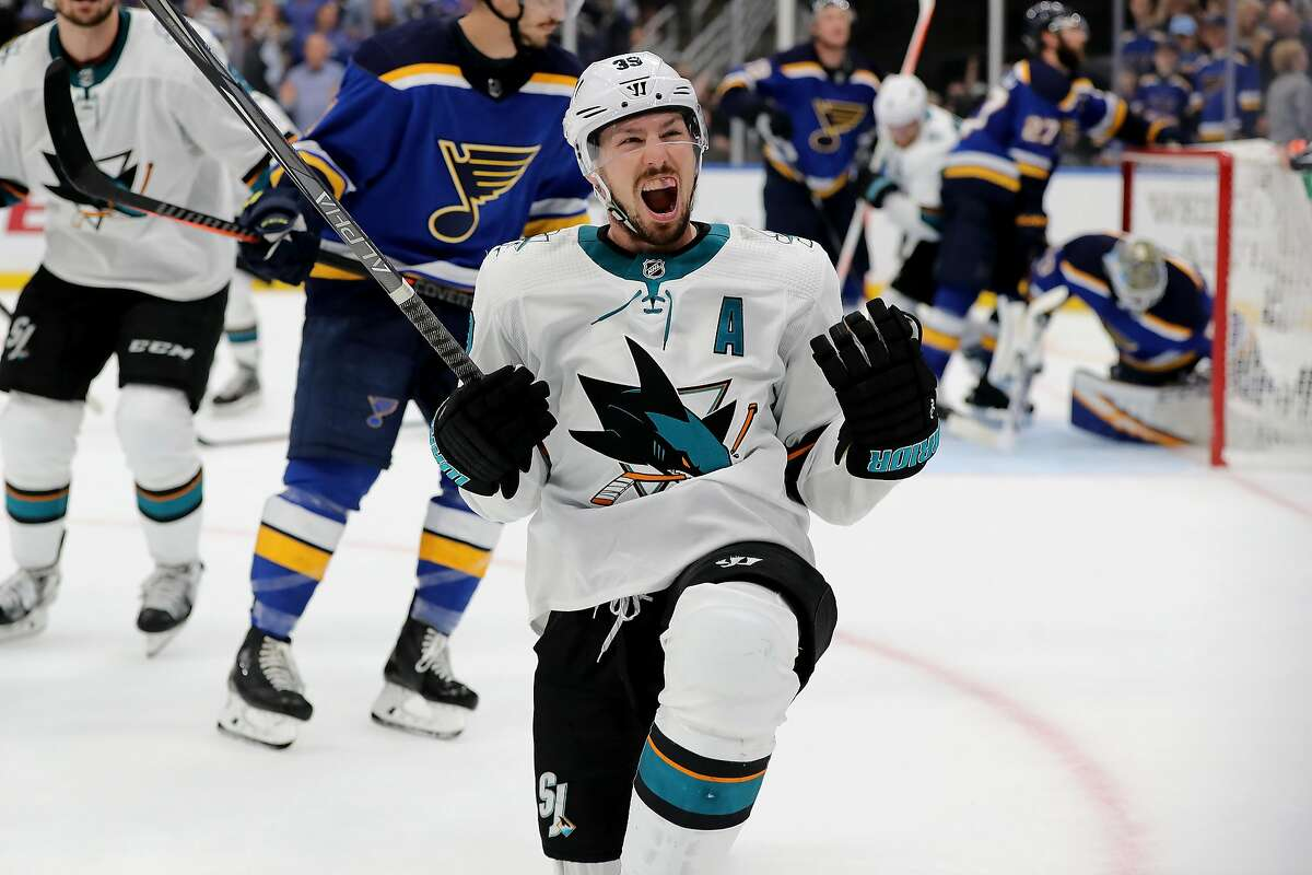 ST LOUIS, MISSOURI - MAY 15: Logan Couture #39 of the San Jose Sharks celebrates after scoring a goal on Jordan Binnington #50 of the St. Louis Blues during the third period in Game Three of the Western Conference Finals during the 2019 NHL Stanley Cup Playoffs at Enterprise Center on May 15, 2019 in St Louis, Missouri. (Photo by Elsa/Getty Images) *** BESTPIX ***