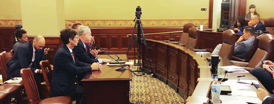 Madison County Board Chairman Kurt Prenzler, left, and State Rep. Jay Hoffman testify Wednesday during the House Executive Committee on Senate Bills 584 and 1418, calling for restructuring of appointments on Metro East Sanitary District and Bi-State Development Agency board.