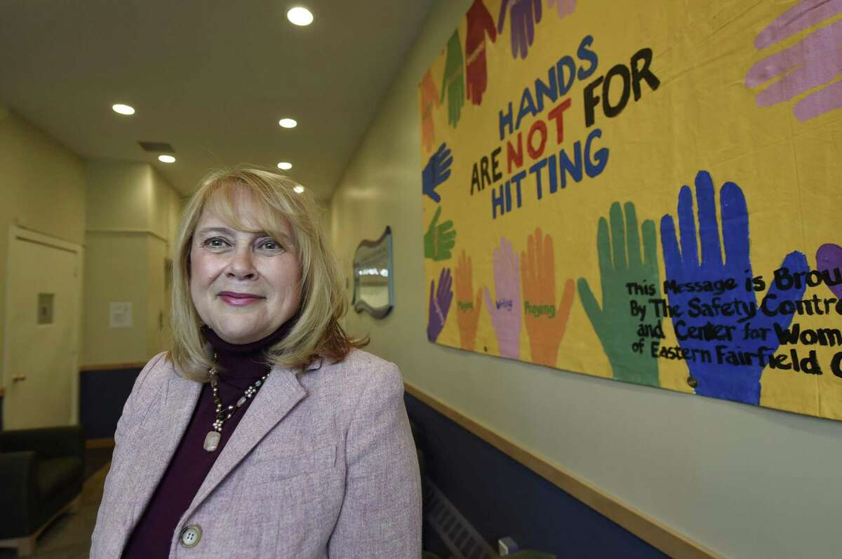 ADVANCE FOR WEEKEND EDITIONS MARCH 12-13 - In this Feb. 16, 2016 photo, Debra Greenwood is president and chief executive officer of the Center for Family Justice in Bridgeport, Conn.. The facility is undergoing a renovation to be able to provide an array of services for victims of domestic violence under one roof. She is pictured in the lobby of the center. (Cloe Poisson/Hartford Courant via AP) MANDATORY CREDIT