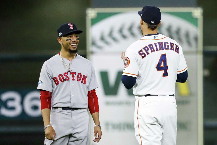 Red Sox outfielder Mookie Betts, who won last year's AL MVP award, chats it up with the Astros' George Springer, a contender for this year's honor, during last year's American League Championship Series. Photo: Karen Warren, Houston Chronicle / Staff Photographer / © 2018 Houston Chronicle