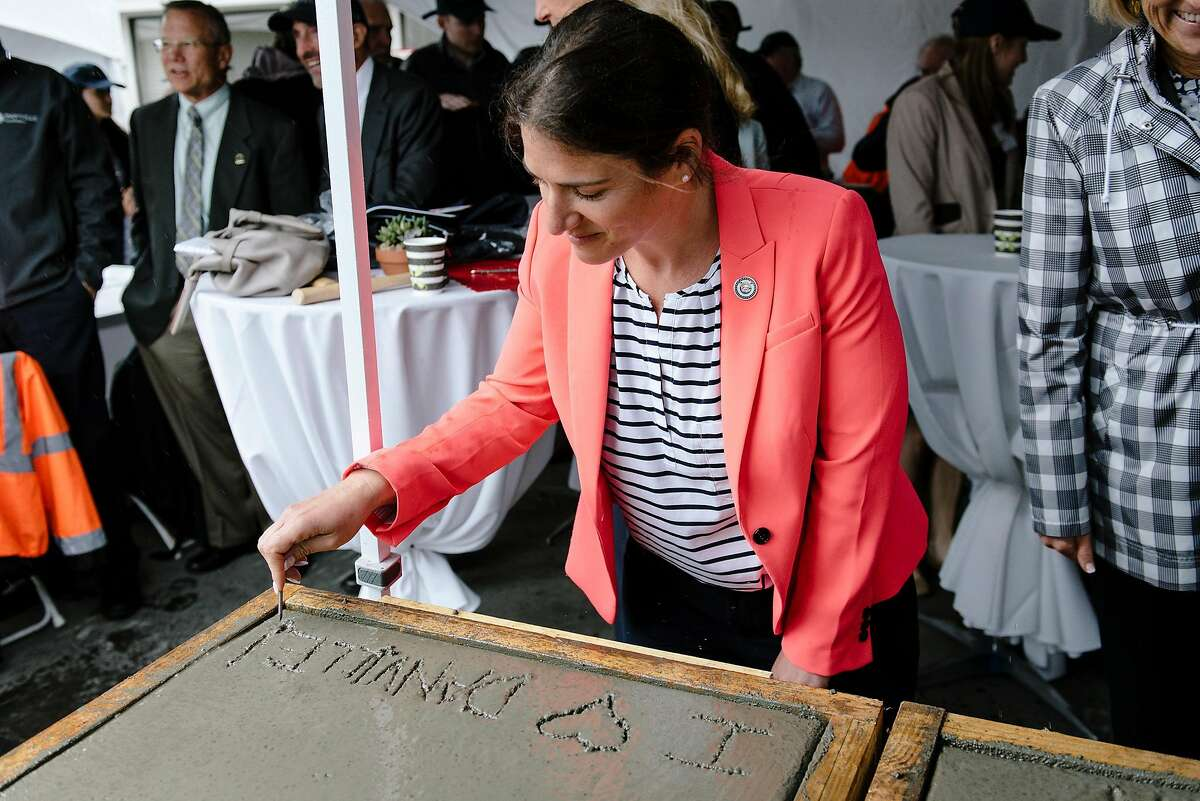 Assembly member Rebecca Bauer-Khan signs a slab of cement during an Alexan Downtown Danville multifamily housing development framing ceremony in Danville, Calif, on Wednesday, May 15, 2019.