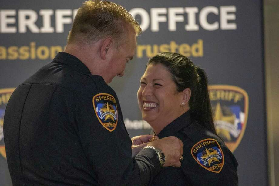 Lt. Stephanie Logan smiles as Sheriff Rand Henderson pins her badge to her uniform during a Montgomery County Sheriff's Office promotion ceremony Thursday, May 16, 2019 at The Lone Star Convention & Expo Center in Conroe. Photo: Cody Bahn, Houston Chronicle / Staff Photographer / © 2018 Houston Chronicle
