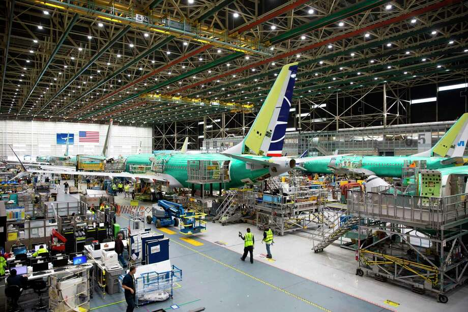 (FILES) In this file photo taken on March 27, 2019 employees work on Boeing 737 MAX airplanes at the Boeing Renton Factory in Renton, Washington. - Boeing said on May 16, 2019 that it completed its software update on the 737 MAX after two deadly crashes resulted in a global grounding of the aircraft. The proposed fix must now win approval from US and international regulators before the planes can return to service. (Photo by Jason Redmond / AFP)JASON REDMOND/AFP/Getty Images Photo: JASON REDMOND / AFP or licensors