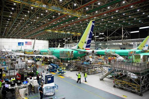 (FILES) In this file photo taken on March 27, 2019 employees work on Boeing 737 MAX airplanes at the Boeing Renton Factory in Renton, Washington. - Boeing said on May 16, 2019 that it completed its software update on the 737 MAX after two deadly crashes resulted in a global grounding of the aircraft. The proposed fix must now win approval from US and international regulators before the planes can return to service. (Photo by Jason Redmond / AFP)JASON REDMOND/AFP/Getty Images