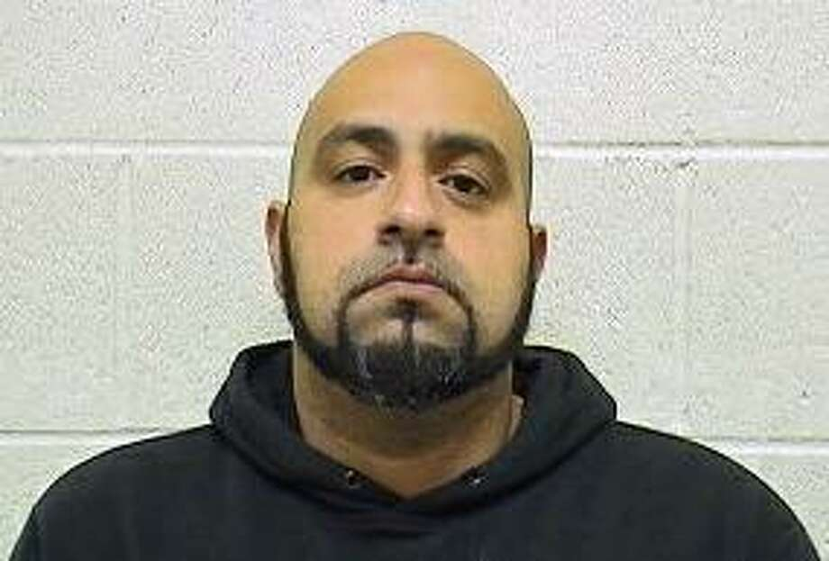 Gary Rodriguez, 36, was charged with possession with intent to sell cocaine and three counts of criminal possession of a firearm. Photo: Contributed Photo / Torrington Police Department