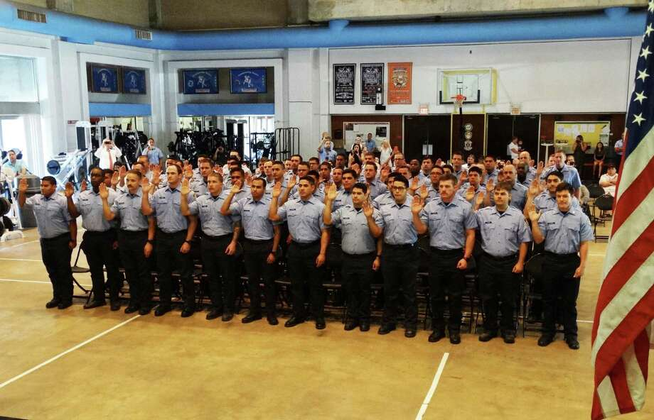 The city swore in 66 Houston fire cadets Thursday. Mayor Sylvester Turner rescinded layoff notices issued to the cadets last month after a state district judge on Wednesday declared Proposition B unconstitutional. The mayor said he would rescind layoff notices sent to nearly 200 firefighters and municipal workers, too. Photo: Courtesy Of HFD / handout