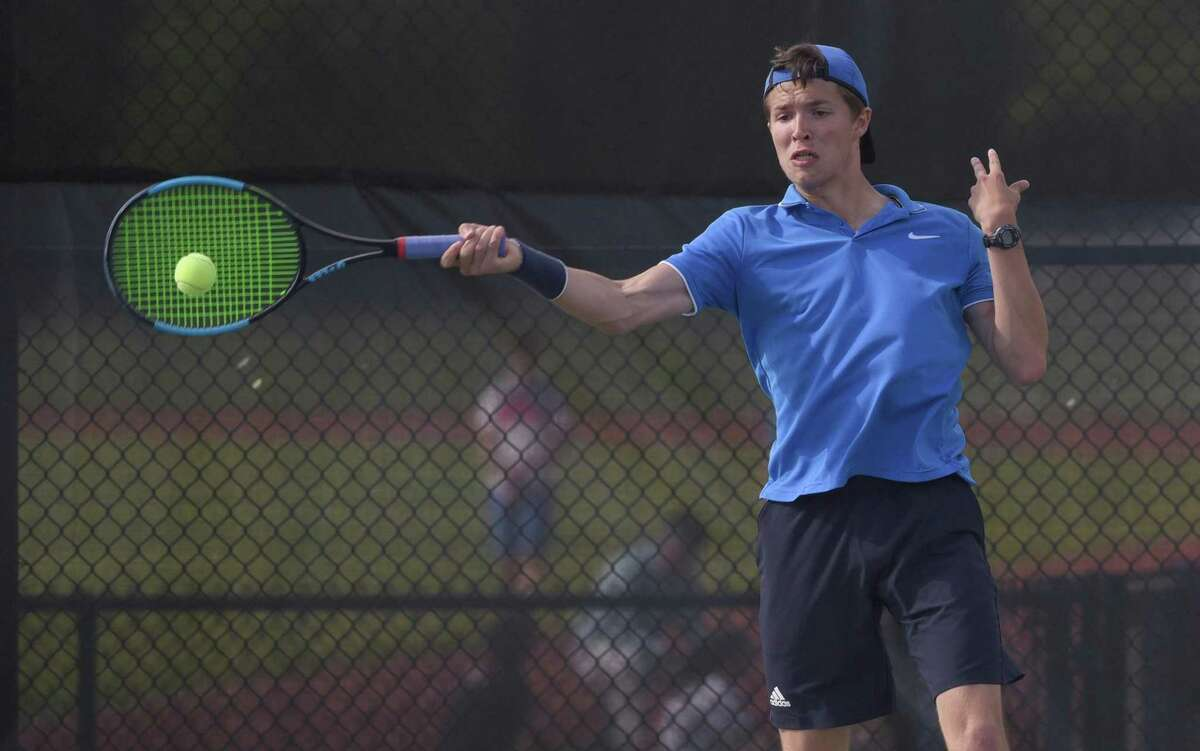 Darien's Michael Karr, seen here against New Canaan on May 16, advanced to the State Open final.