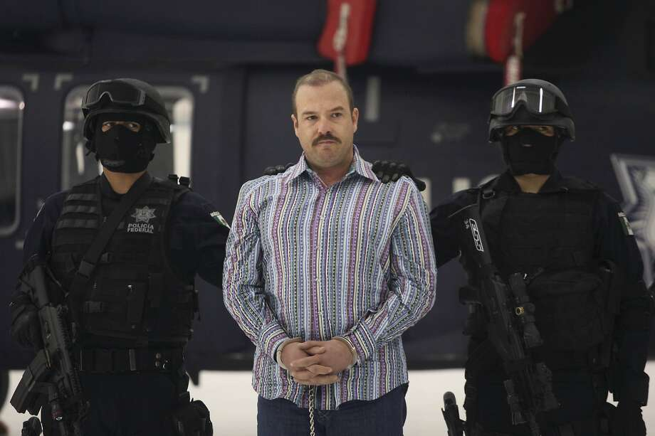 "Federal Police officers escort accused drug trafficker Carlos Montemayor during a presentation for the media in Mexico City, Wednesday, Nov. 24, 2010. According to Federal Police Montemayor took over the criminal organization led by Edgar Valdez Villareal, aka ""La Barbie"", a reputed US-born kingpin after he was detained. Photo: Alexandre Meneghini, AP"