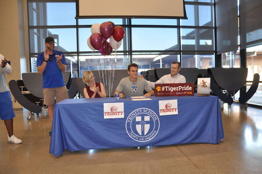 Trinity School's Evan Witt, seated center, signed a letter-of-intent to run track at Trinity University. Photo: Courtesy Photo