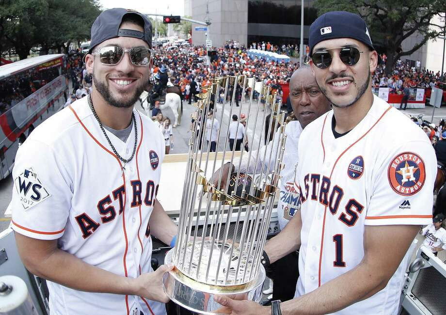 George Springer, left, and Carlos Correa are two parts of a remarkable nucleus that has the Astros aiming for more than just their 2017 championship. Photo: Karen Warren,  Staff / Houston Chronicle / © 2017 Houston Chronicle
