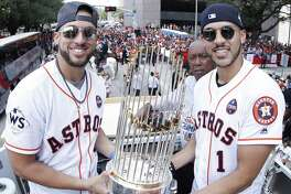 George Springer, left, and Carlos Correa are two parts of a remarkable nucleus that has the Astros aiming for more than just their 2017 championship.