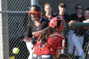 Edwardsville's Sydney Lawrence scores in the fourth inning as the ball gets away from Alton catcher Audrey Evola on Thursday in Alton.