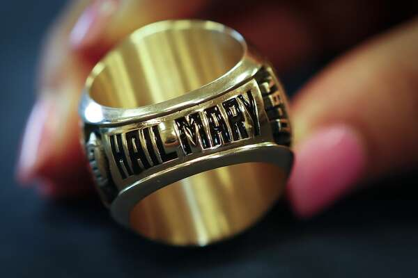 Hail Mary is inscribed on the bottom of North Shore head coach Jon Kay's state championship ring before a ring ceremony for the players Thursday, May 16, 2019, in Houston. Last fall North Shore captured its third state championship in a 41-36 win over Duncanville on a Hail Mary touchdown pass as time ran out.