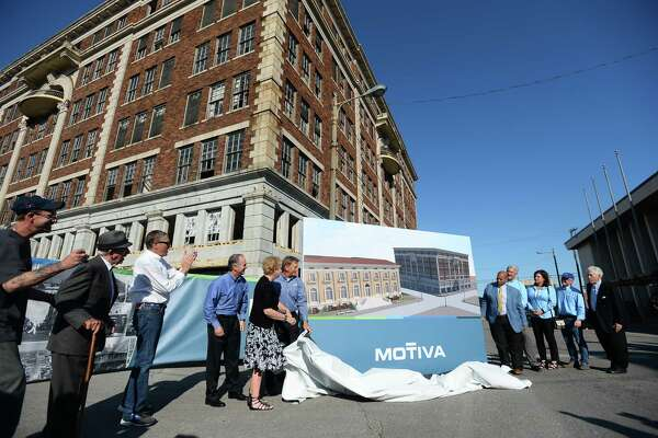 "People from Motiva and Port Arthur unveil building plans in front of the Adams building during Motiva and The Greater Port Arthur Chamber of Commerce's ""Imagine Port Arthur"" in downtown Port Arthur Thursday. Photo taken on Thursday, 05/16/19. Ryan Welch/The Enterprise"