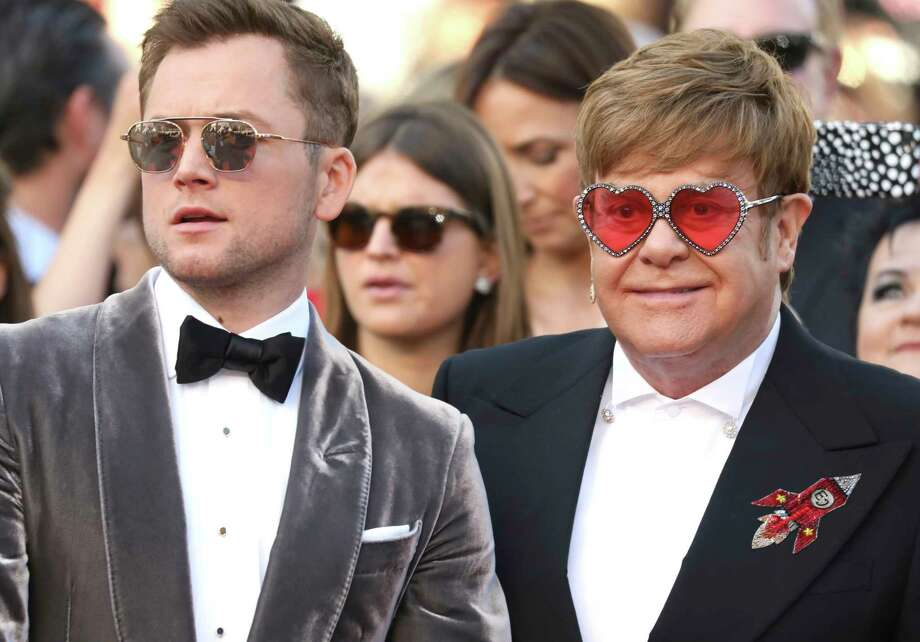 Actor Taron Egerton, left, and singer Elton John pose for photographers upon arrival at the premiere of the film 'Rocketman' at the 72nd international film festival, Cannes, southern France, Thursday, May 16, 2019. (Photo by Vianney Le Caer/Invision/AP) Photo: Vianney Le Caer / Invision