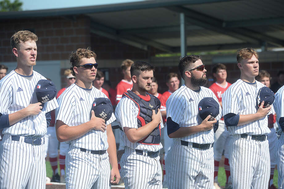 Hardin - Jefferson's Hawks line up for the anthem before facing Huffman during the first game of their regional quaterfinal double header Thursday in Anahuac. Photo taken Thursday, May 16, 2019 Kim Brent/The Enterprise Photo: Kim Brent, The Enterprise / BEN