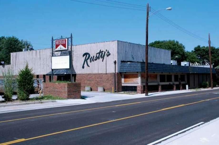 The former Rusty's site on North Main has had multiple plans since closing in 2008. The latest one involves demolishing the historic Pogue Store walls, re-discovered in 2015. The store, built in 1819, was Edwardsville's first brick building.
