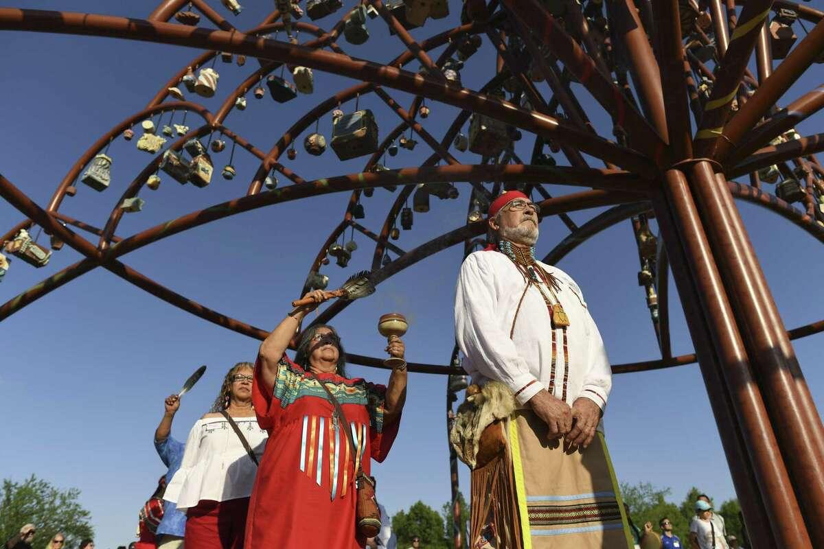 "Roy V. Guerrero and other members of the Tehuan Band of Mission Indians recite a prayer during an unveiling ceremony for artist Margarita Cabrera's artwork ""Árbol de la Vida: Memorias y Voces de la Tierra"" near Mission Espada."
