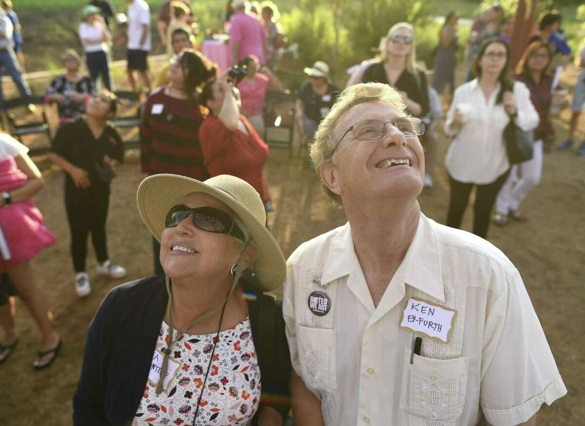 Beatrice Quintero and Ken Erfurth enjoy the art piece, which took about three years to complete and cost $980,000.