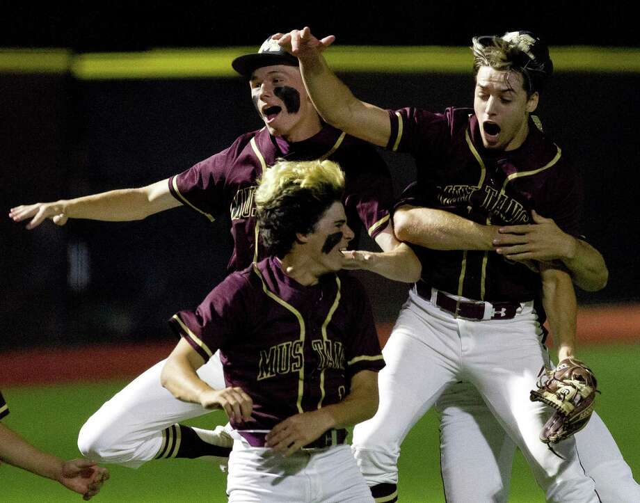 Magnolia West starting pitcher Connor Phillips (9) celebrates with teammates after striking out Jake Johnson #20 of Tomball to earn a 1-0 win in Game 1 of a Region III-5A quarterfinal high school baseball series at Grand Oaks High School, Thursday, May 16, 2019, in Spring. Photo: Jason Fochtman, Houston Chronicle / Staff Photographer / © 2019 Houston Chronicle