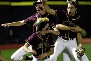 Magnolia West starting pitcher Connor Phillips (9) celebrates with teammates after striking out Jake Johnson #20 of Tomball to earn a 1-0 win in Game 1 of a Region III-5A quarterfinal high school baseball series at Grand Oaks High School, Thursday, May 16, 2019, in Spring.