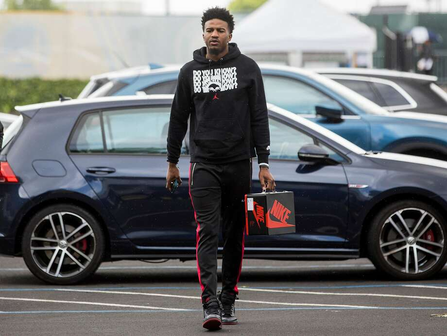 Warriors' Jordan Bell carries a Nike tin shoebox as he arrives ahead of game 2 of the Western Conference Finals between the Golden State Warriors and Portland Trail Blazers at Oracle Arena in Oakland, Calif. Thursday, May 16, 2019. Photo: Jessica Christian / The Chronicle