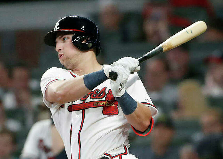 Atlanta Braves rookie Austin Riley follows through on a base hit in the fifth inning Thurdday night against the Cardinals in Atlanta. Photo: AP Photo